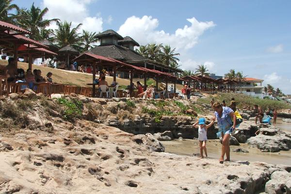 Na beira da praia de Cotovelo e filial em Santa Rita