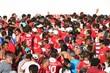Multidão de torcedores comprando ingresso antes do começo do jogo